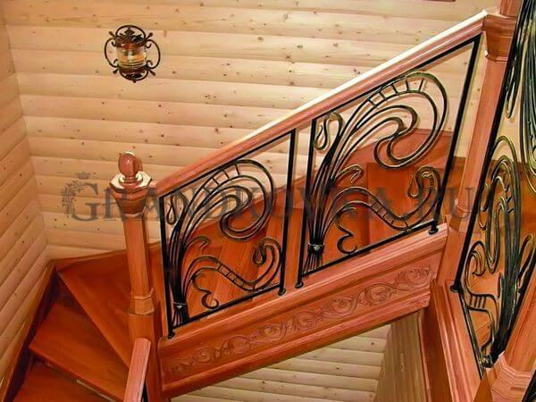 Фото кованой лестницы на второй этаж дома 1